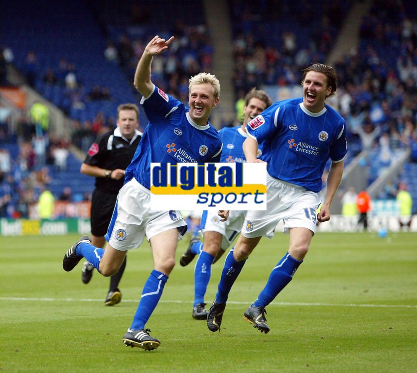Photo: Chris Ratcliffe.<br />Leicester City v Ipswich Town. Coca Cola Championship. 12/08/2006.<br />Stephen Hughes (C) celebrates putting Leicester into a 2-0 lead as Eric Nils-Johansson chases him (R).