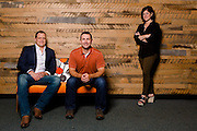 Nicholas Sammer, Acumen Brands VP and General Manager, Greg Primm , VP of operations, and Lela Davidson, VP of Media and Entertainment, pose for a photo in their office in Fayetteville, Ark.