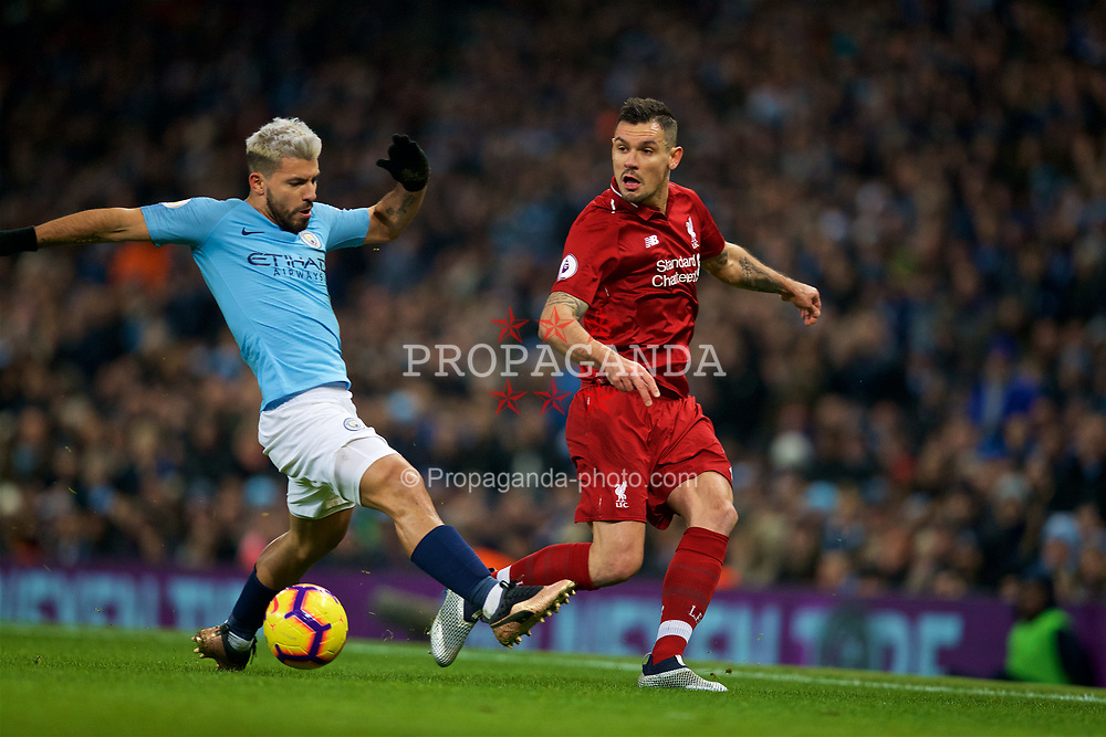 MANCHESTER, ENGLAND - Thursday, January 3, 2019: Liverpool's Dejan Lovren (R) and Manchester City's Sergio Aguero during the FA Premier League match between Manchester City FC and Liverpool FC at the Etihad Stadium. (Pic by David Rawcliffe/Propaganda)