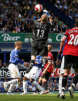Photo: Paul Thomas.<br /> Everton v Manchester United. The Barclays Premiership. 28/04/2007.<br /> <br /> John O'Shea (L) of Utd scores their first for the after noon from this mistake by Everton keeper Iain Turner (13).