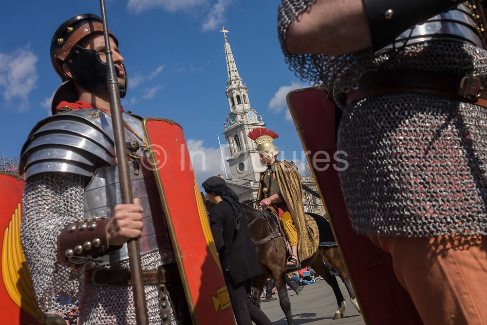 London, 25th March 2016: Actors dressed as Roman soldiers parade at the beginning of The Passion of Jesus, performed in Londons Trafalgar Square by members of Wintershall Trust. Played annually on Good Friday it celebrates the cruxifixion and resurrection of Jesus Christ. The cast re-enacts the Christian Biblical story to an audience of thousands and the main character is played by professional actor James Burke-Dunsmore. .