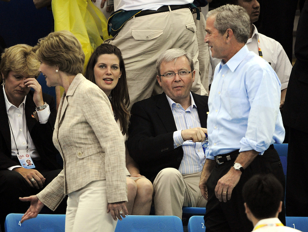 It is day two of swimming at the 2008 Beijing Olympics and Prime Minister Kevin Rudd (L) was expecting to meet and greet US President George Bush. However at the last second Bush walks past Rudd in an embarrassing moment for the PM. (Copyright Michael Dodge/Herald Sun)