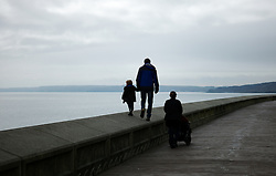 © Licensed to London News Pictures. <br /> 05/04/2015. <br /> <br /> Scarborough, United Kingdom<br /> <br /> A family walk along the promenade on Easter Sunday in Scarborough, United Kingdom.<br /> <br /> Photo credit : Ian Forsyth/LNP
