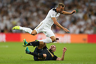 Kamil Glik of AS Monaco sends Harry Kane of Tottenham Hotspur flying. UEFA Champions league match, group E, Tottenham Hotspur v AS Monaco at Wembley Stadium in London on Wednesday 14th September 2016.<br /> pic by John Patrick Fletcher, Andrew Orchard sports photography.
