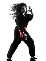 one caucasian woman practicing martial arts Kung Fu Pencak Silat in studio isolated on white background