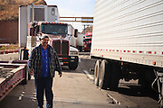 19 DECEMBER 2008 -- NOGALES, SON, MEX: Nicolas Antonio Garcia Castro, a Mexican truck driver, walks along the line of trucks waiting on the Mexican side of the Mariposa port of Entry in Nogales. PHOTO BY JACK KURTZ