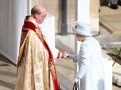 Queen Elizabeth II arrives for the wedding of Princess Eugenie to Jack Brooksbank at St George's Chapel in Windsor Castle.