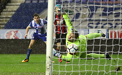 Wigan Atheltic's Callum Elder (left) scores his side's third goal of the game during the Emirates FA Cup, Third Round Replay at the DW Stadium, Wigan.