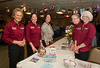 President Penny Pitou, Vice President Kim Terrio, Andrea McClure from Regent Seven Seas and travel agents Sandy Delude and Hansi Glahn during the travel trade show with Penny Pitou Travel at the Margate on Saturday afternoon.    (Karen Bobotas/for the Laconia Daily Sun)