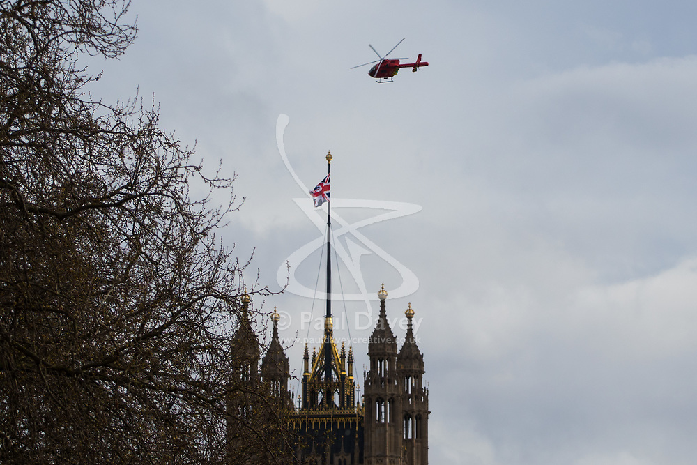 London, March 22nd 2017. The air ambulance leaves Parliament Square in the aftermath of a shooting incident on Westminster Bridge, where several pedestrians were also mown down by a car.