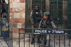 Isreali police inside the old city of Jerusalem. From a series of photos commissioned by  British NGO, Medical Aid for Palestinians (MAP).