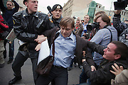 Moscow, Russia, 31/08/2010..One demonstrator tries to pull another from the arms of police as they arrest him while  they break up an opposition protest in central Moscow and arrest around 70 people. Opposition activists hold regular demonstrations on the 31st day of the month, protesting against restrictions on the freedom of assembly, which is protected by article number 31 of the Russian constitution.