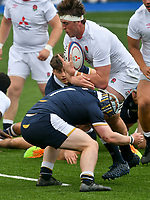 Rugby Union - 2021 U20 Six Nations - Round Two - England vs Scotland - Cardiff Arms <br /> <br /> Alex Groves England Under 20s tackled by Michael Jones Scotland Under 20s<br /> <br /> COLORSPORT/WINSTON BYNORTH