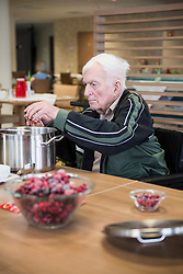 Senior man preparing marmalade in rest home