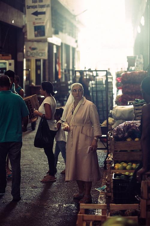 A nun shops for produce at Rio de Janeiro's CADEG Market.