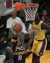 October 25, 2018 - Los Angeles, California, U.S - Monte Morris #11 of the Denver Nuggets goes for a reverse shot past Lance Stephenson #6 of the Los Angeles Lakers  during their NBA game on Thursday October 25, 2018 at the Staples Center in Los Angeles, California. Lakers defeat Nuggets, 121-114. (Credit Image: © Prensa Internacional via ZUMA Wire)