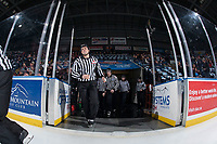 KELOWNA, CANADA - FEBRUARY 17: Linesmen Dustin Minty enters the ice with young BC Hockey officials at the Kelowna Rockets against the Edmonton Oil Kings  on February 17, 2018 at Prospera Place in Kelowna, British Columbia, Canada.  (Photo by Marissa Baecker/Shoot the Breeze)  *** Local Caption ***