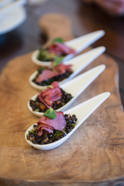 Black gram and ham as appetizer on spoons