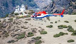 """THEMENBILD - Hubschrauber am Flugfeld Syangboche, das sich oberhalb von Namche Bazaar befindet. Wanderung im Sagarmatha National Park in Nepal, in dem sich auch sein Namensgeber, der Mount Everest, befinden. In Nepali heißt der Everest Sagarmatha, was übersetzt """"Stirn des Himmels"""" bedeutet. Die Wanderung führte von Lukla über Namche Bazar und Gokyo bis ins Everest Base Camp und zum Gipfel des 6189m hohen Island Peak. Aufgenommen am 10.05.2018 in Nepal // Trekkingtour in the Sagarmatha National Park. Nepal on 2018/05/10. EXPA Pictures © 2018, PhotoCredit: EXPA/ Michael Gruber"""