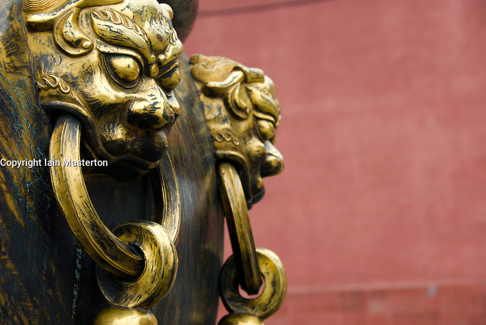 Detail of large bronze urn with ornate handles in Forbidden City Beijing