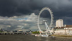 London Eye and dark cloudy weather, England, UK. 12/05/14. Photo by Andrew Tallon