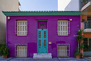 Purple architecture. A renovated neoclassic style house painted with a fresh coat of purple paint. Athens, Greece