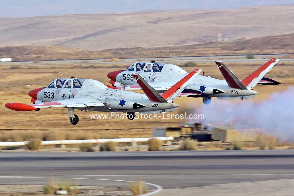 2 Israeli Air force Fouga Magister CM-170 aerobatics display at takeoff
