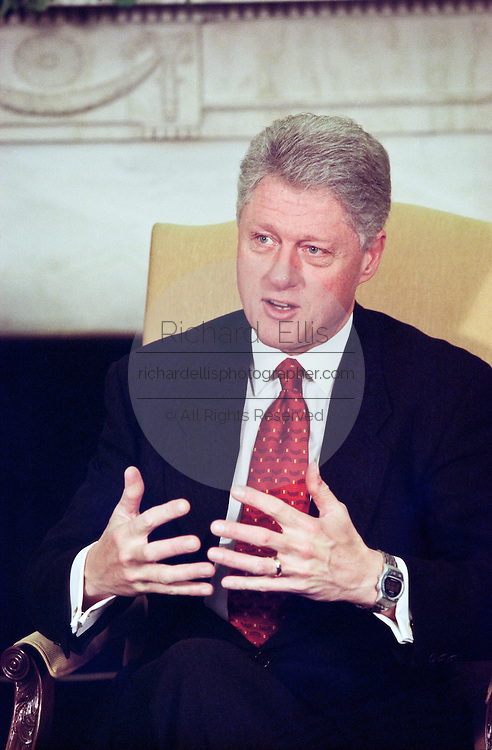 US President Bill Clinton comments during a meeting with NATO Secretary General Javier Solana March 15, 1999 in the Oval Office at the White Hose in Washington, DC. During the meeting President Clinton said he is optimistic at the news that the Kosovaars are willing to sigh a peace agreement with the Serbs.