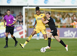Sutton United's Alistair Smith (left) and Port Vale's Tom Conlon battle for the ball during the Sky Bet League Two match at Borough Sports Ground, Sutton. Picture date: Saturday October 9, 2021.