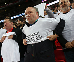 10 November 2017 Wembley: Friendly International Football Match - England v Germany: a fan struggles to pull on his armistice day T-Shirt.<br /> Photo: Mark Leech