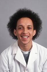 Portrait of man wearing white coat smiling,