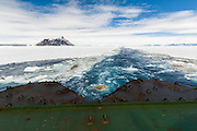 The cushioned stern of a Russian icebreaker with Cockburn Island on the horizon, Admiralty Sound, Weddell Sea, Antarctic Peninsula