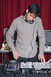 DJ using mixing desk to make music,