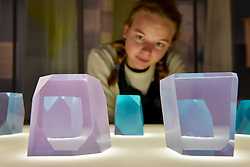 """© Licensed to London News Pictures. 27/06/2017. London, UK. A staff member views """"Crystal Stones"""", 2017, in morning light.  Preview of """"Breathing Colour"""", an exhibition by acclaimed designer Hella Jongerius, at the Design Museum, Kensington which comprises a series of newly commissioned installations exploring humans perceptions and connections to colour.  The exhibition runs from 28 June to 24 September 2017.  Photo credit : Stephen Chung/LNP"""
