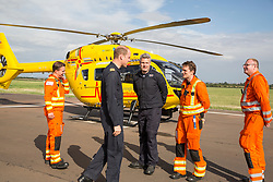 The Duke of Cambridge Poses for a final photo with the night shift crew as he starts his final shift with the East Anglian Air Ambulance based at Marshall Airport near Cambridge. (left to right) Dr Adam Chesters, Prince William, Cpt Dave Kelly, Dr Tobias Gouse and CCP Carl Smith.