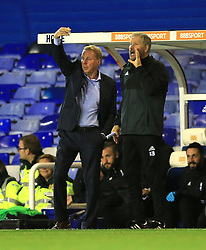 Birmingham City's manager Harry Redknapp (left) and assistant Kevin Bond gestures on the touchline against Crawley Town