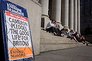 "City workers enjoy warm sunshine  walk near David Cameron's Conservative party's election promise on Evening Standard headline in the City of London. David Cameron has said his aim is to guarantee a ""good life"" for British workers and families as he launched the Conservatives' election manifesto. The prime minister said he wanted ""to finish the job"" of rebuilding Britain on behalf of ""working people"". Labour said the Conservatives were the ""party of the richest in society""."