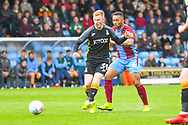 Lewis O'Brien of Bradford City (39) passes the ball during the EFL Sky Bet League 1 match between Scunthorpe United and Bradford City at Glanford Park, Scunthorpe, England on 27 April 2019.