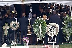 Music mogul Diddy joins Kim Porter's grandma at the memorial gardens where former girlfriend Kim Porter, the mother of three of his children, will be laid to rest. Diddy could also be seen having some time away from the crowds to be alone with Kim Porters tomb before bringing the crowds together for a firework display across the waters. Mourners arrived at Evergreen Memorial Park After the funeral service at Cascades Hills Church in the former model's hometown of Columbus, Georgia. Diddy overcame his grief to deliver a moving eulogy. Others who gave eulogies included Blige, Dallas Austin, Bishop Noel Jones and Porter's son, Usher, actor and singer Quincy Brown. Quincy broke down as he spoke and was joined at the mic by his father, Al B. Sure!, and Diddy. The service was packed with celebrities including best friend Kimora Lee Simmons, Missy Elliot, Lil Kim, Tichina Arnold, NeNe Leakes, Fat Joe, Kandi Burress, Winnie Harlow, Ryan Destiny, Stevie J and more. Porter died after suffering from a bout of pneumonia but her exact cause of death is unknown. She was just 47. Diddy, 49, and Porter were together, off and on, for 10 years, and although they were no longer a couple, they were still close, sharing three children: son Christian, 20, and twin daughters D'Lila Star and Jessie James, who turn 12 next month. They also raised 27-year-old Quincy Brown, Porter's son with singer and record producer Al B. Porter died at her Los Angeles home on Nov. 15. An autopsy was performed the next day but the results were deferred for further testing, which could take weeks. 24 Nov 2018 Pictured: P Diddy, Diddy, Sean Combs, usher. Photo credit: MEGA TheMegaAgency.com +1 888 505 6342