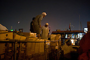 Dubai, United Arab Emirates (UAE). January 29th 2009..Dubai Creek, Deira..People laod and unload cargo for exportation and importation to and from Iran and India..