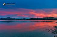Fiery sunset clouds over Flathead Lake in Dayton, Montana, USA