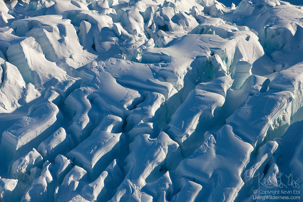 Giant crevasses at the head of the Fox Glacier are visible from this aerial view taken in Westland National Park, New Zealand.