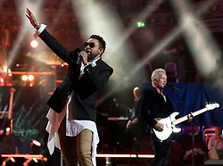 Shaggy (left) and Sting perform at the Royal Albert Hall in London during a star-studded concert to celebrate the Queen's 92nd birthday.