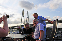 Passengers on the Viking Truvor say farewell to St. Petersburg as they pass under a suspension bridge headed east along the Volga-Baltic Waterway to Moscow, Russia, a journey of 700 miles.