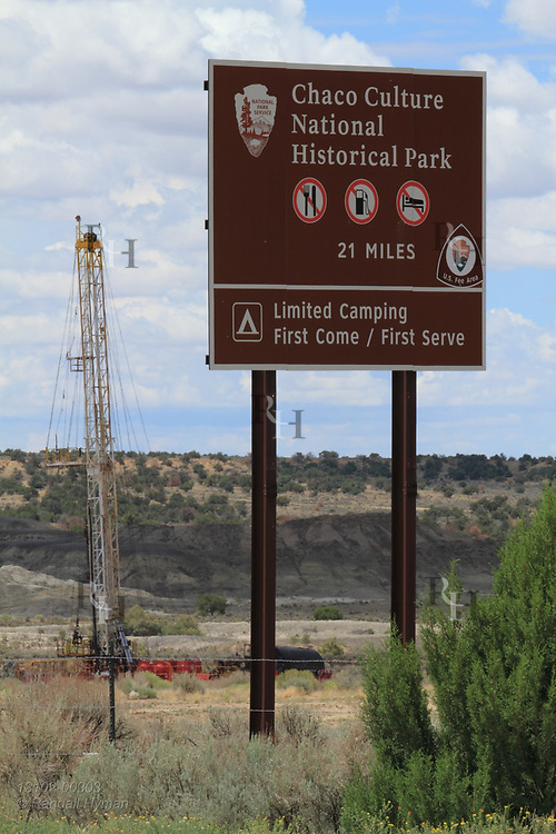 Drill rig at road entrance leading to Chaco Culture National Historical Park reminds visitors of encroaching threat from oil and gas industry, New Mexico.