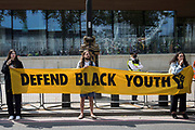 Activists hold a Defend Black Youth banner outside New Scotland Yard during a Kill The Bill National Day of Action in protest against the Police, Crime, Sentencing and Courts PCSC Bill 2021 on 29th May 2021 in London, United Kingdom. The PCSC Bill would grant the police a range of new discretionary powers to shut down protests, including the ability to impose conditions on any protest deemed to be disruptive to the local community, wider stop and search powers and sentences of up to 10 years in prison for damaging memorials.