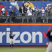 NEW YORK, NEW YORK - MAY 04:  Fans celebrate catching the ball of a Lucas Duda #21 of the New York Mets some run during the Atlanta Braves Vs New York Mets MLB regular season game at Citi Field on May 04, 2016 in New York City. (Photo by Tim Clayton/Corbis via Getty Images)