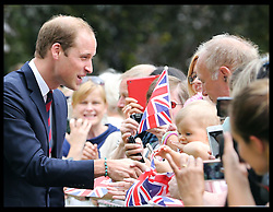 Image licensed to i-Images Picture Agency. 16/07/2014. Coventry, United Kingdom. The Duke of Cambridge wearing a loom band given to him by a member of the public in the crowd during a visit to the War Memorial Park in Coventry. Picture by Stephen Lock / i-Images
