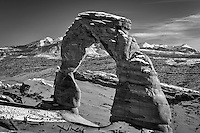 Delicate Arch in Arches National Park near Moab, Utah as the sun begins to set on a warm Winter evening.