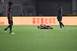 SHANGHAI, July 19, 2017  Franck Ribery (C) of Bayern Munich falls on the ground during the match between Arsenal and Bayern Munich of 2017 International Champions Cup China in Shanghai, China, July 19, 2017. (Credit Image: © Jia Yuchen/Xinhua via ZUMA Wire)